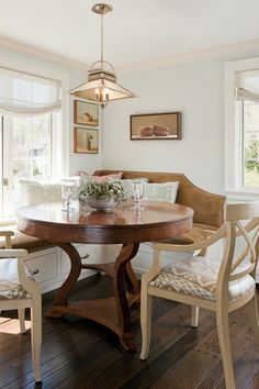 <3 this Breakfast Nook with wonderful, round table and banquette