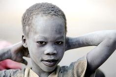 In 2008 in Sudan, a boy, covered in dust and sand, smiles in the town of Juba, Southern Sudan. Most members of the community are internally displaced due to continuing conflict.  -   © UNICEF/NYHQ2008-1782/Giacomo Pirozzi  -  To learn more about South Sudan, please visit: http://uni.cf/IMWD9B