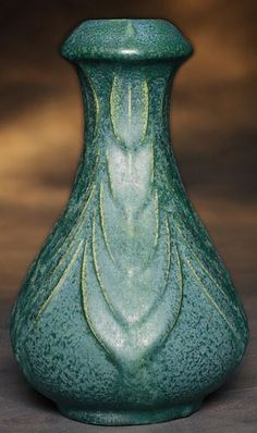 """Van Briggle vase, ca.1907-1912, unusual form with carved organic design covered with a multi-tone green matt glaze, incised marks, 6""""h  
