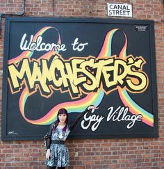 manchester gay village, lgbt manchester england, british gay pride mural, rainbow sign.  More at http://www.lacarmina.com/blog/2015/07/alice-wonderland-tearoom-manchester-gay-district/