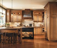 I like the cabinets to the ceiling and the hood. The glass insert on the top cabiniets Caldwell doors are adorned with elegant and ornate detailing, providing depth, dimension and character to your cabinets.