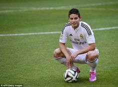 James Rodriguez poses at his Real Madrid unveiling just a year on from moving to Monaco fr...