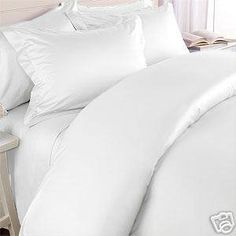 White bedding is a must.. makes you feel although you are sleeping on a cloud