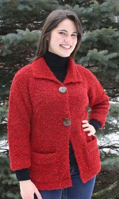 2-button Swing Alpaca Cardigan  This Alpaca boucle swing cardigan sweater is great for keeping you cozy and warm on a chilly day or evening. It has 2 large wooden buttons for the closure and two front pockets. It is knit with a melange yarn of 3 to 5 colors mixed together in a loopy yarn that is soft to touch, rich in color and texture.   www.purelyalpaca.com