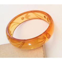 Apple Juice Bakelite Bangle Bracelet, Reverse Carving, 1930s Art Deco... ($654) ❤ liked on Polyvore featuring jewelry, bracelets, art deco jewellery, vintage bangle bracelet, art deco jewelry, bangle jewelry and hinged bracelet