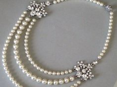 Bridal jewelry - Wedding Necklace - Bridal accessory - Triple strand bridal pearl necklace - Swarovski Pearl necklace. $125.00, via Etsy.