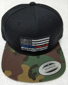 167bd941d94 Thin Blue Line   Thin Red Line Snapback hat with black top and camouflage  brim.
