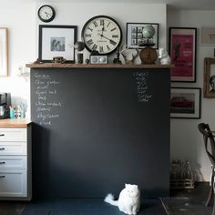 Blackboard paint is a useful way to create a bespoke 'chore' or 'shopping' list in a kitchen. Here, a feature has been made of the blackboard, with personal memorabilia and a statement clock placed above it, as if it were a fireplace. Blackboard Paint, Chalk Wall, Chalk Board, Chalkboard Walls, Kitchen Blackboard, Chalkboard Ideas, Chalk Paint, European Decor, European Style