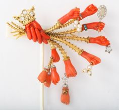 A coral surrealist hand brooch circa 1960 by Marchak Photo courtesy of Pat Saling
