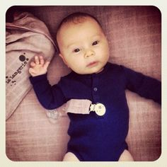 a precious baby on our swaddling rose poudre blanket ...http://lalangerie.com/