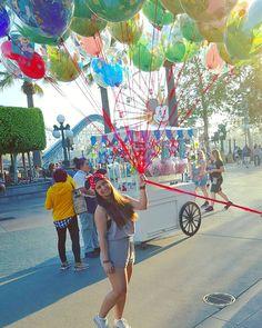 Magic is in the air  #TakeMeBack #NeedMyFix #disney #magic #DiamondCelebration #HappiestPlaceOnEarth #HappyGirl #Disneyland #CaliforniaAdventure #disneyballoons #colorful #balloons #sunshine #paradisepier #ferriswheel #minnie #snapback by linneasaurusrex