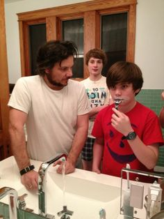 Jeff Tweedy teaching one of his sons how to shave. Obviously.