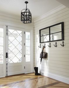 Gorgeous wood inlay flooring and plank walls; contrasting mirror, anchor hooks and pendant lamp / Muskoka Living |ML