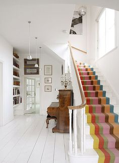 super love this.  the striped stairs, all the white painted wood, the piano!