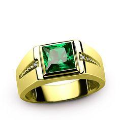 Metal: 14k Yellow Gold Emerald: carat total weight - 3.20  dimensions - 0.7cm x 0.7cm  setting - Bezel setting Diamonds: carat