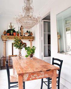 mantle + mirror + chandy + white walls & floors + raw table (fancy balcony)