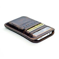 Slim leather wallet and phone case.