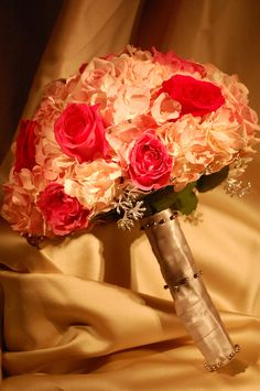 Prime rose bride bouquet with touches of light pink hydrangea.