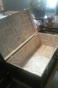Bought this trunk for $10 at a yard sale and the inside was just pressed wood chips so I modge podged old dictionary pages to the inside.