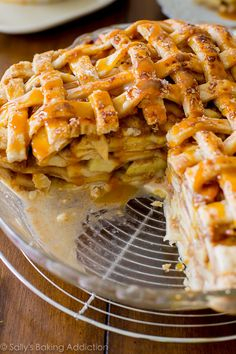 Here is a classic lattice-topped all American apple pie bubbling with salted caramel and gooey, cinnamon apples!