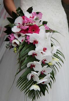 Cascading wedding bouquet with Phalaenopsis orchids, Gerbera daisies, lily of the valley, and sweet peas.