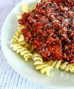 Italian Meat Sauce and Pasta is made by boiling the pasta, then addingt eh meat sauce made by simmering the ingredients together
