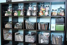 How to organize materials on Expedit Bookcase. Love the jars!