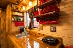To save counter space, the Caboose kitchen has built-in shelves for storing dishes and spices.