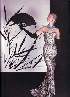 Model wearing a beaded leopard print evening gown, 1953.