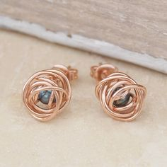 Rose Gold Caged Dark Pearl Stud Earrings - A striking, contemporary yet elegant design featuring exquisite and intricate craftsmanship where a single, peacock freshwater pearl is cleverly encased within a rose gold plated silver wire cage to create these Rose Gold Caged Dark Pearl Stud Earrings. #Otisjaxon #Jewellery #MothersDay #Present