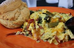 The Flying Biscuit's Souther Scramble.....eggs, trukey bacon, spicy collard greens, onions, and cheddar cheese all scambled together.