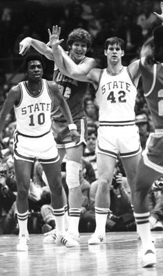 Moe Rivers and Tim Stoddard guarding Bill Walton during North Carolina  State University s win over UCLA in a 1974 NCAA basketball tournament  semi-final game ... abbdfde14