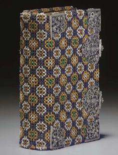 12o (139 x 81 mm). Engraved frontispiece and engraved plates. Late 17th or early 18th century BEADED BINDING, the sides and spine are covered with woven beads, to a geometic floral design of white, brown and green beads on a blue background, covering a binding of metal threads, silver corner pieces and two clasps; gilt and gauffered edges. Provenance: Maria Margareta Escher (inscription dated 1766); Johann Bechner (inscription 1868); purchased from Emil Offenbacher 2 January 1959.