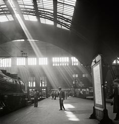 Roman Vishniac, [Sunlight streaming into a railway station, probably the Bahnhof Zoo terminal in Charlottenburg, Berlin], late 1920s-early 1...