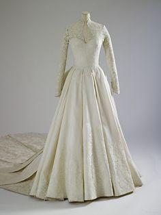 Wedding dress designed by Sarah Burton for Catherine Middleton,...