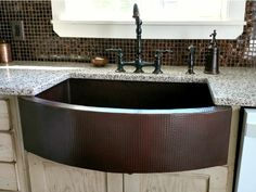 $985 - All of our copper farmhouse sinks are hand-hammered in 14 gauge, lead-free copper by 3rd generation coppersmiths. Our 14 gauge copper is the thickest copper available on the market—you don't need to worry about a metallic drumming sound as water flows into your sink. Our sinks are TIG copper welded and built to last a lifetime! Copper Farmhouse Sinks, Farmhouse Sink Kitchen, Copper Kitchen, Kitchen Sink, Composite Sinks, Custom Cabinets, Front Design, Kitchen Remodel, New Homes