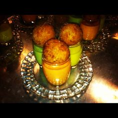 Gazpacho Arancini Trio!    -Red Tomato Gazpacho w/ Roasted Garlic and Mozzarella Arancini  -Green Tomato Gazpacho w/ Marinated Artichoke and Spinach Arancini  -Yellow Tomato Gazpacho w/  Fire Roasted Yellow Pepper and Parmesan Arancini    ::Always a hit!  By Blue Plate Catering in Chicago.