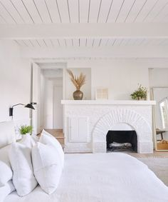 modern whitewashed bedroom with painted white arched fireplace and white bedding by jenni kayne home. Home Bedroom, Master Bedroom, Bedroom Decor, Estilo Interior, Linen Couch, Linen Duvet, Haus Am See, Cabin In The Woods, Lake Arrowhead