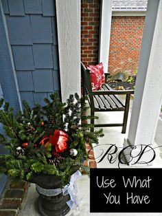 Take your Summer flowers out and stick left over Christmas tree branches in the soil.  Add a gazing ball, and/or some ornaments, then tie a ribbon around it.  Easy!