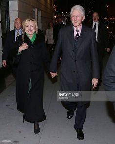 Former Secretary of State Hillary Rodham Clinton and former President of the United States Bill Clinton attend a showing of 'The Last Ship' after the 'Saturday Night Scream Christmas Carols' Benefiting New York Cares Coat Drive on December 20, 2014 in New York City.