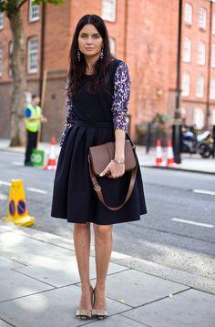 long-sleeved shirt underneath sleeveless dress. louis vuitton shoes. brown shoulder bag.