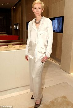 Tilda Swinton in a white suit, gold pumps and Pomellato jewelry at the opening party of Pomellato's boutique on Rodeo Drive in Beverly Hills.