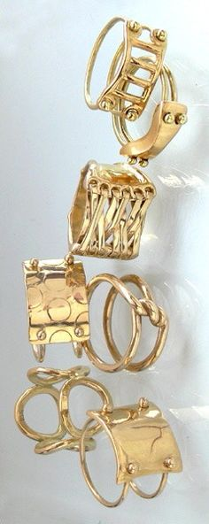 Gold stacking rings | accessories | twist plate lace up designs