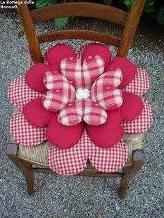 "diy_crafts- ""that's how I can use all of the those stuffed fabric hearts I have!"", ""Cute pillow, wouldn't sit on it. Cute Pillows, Diy Pillows, Decorative Pillows, Throw Pillows, Fabric Hearts, Fabric Flowers, Sewing Crafts, Sewing Projects, Flower Pillow"