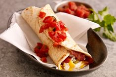 Morning Burrito!  A spicy scramble of egg whites, chiles, and cheese! Topped off with salsa!