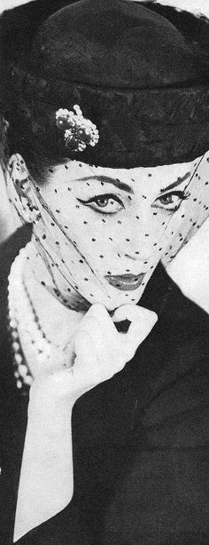 Flickr Dovima in a hat by Pierre Balmain, Vogue March 1956