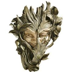 Wood carving, i'd love to have this nestled into some foliage peeking out to say hello
