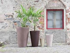 """Liscio Siena Outdoor Planters by Serralunga. This is one of the traditional pot and it is characterized by a slender shape and basic design. This pot is typified by the irregular """"scratched"""" surface. Its dimensions make this pot perfect for both potting plants and flowers and for bedding out flowers with high stems. Suitable for indoor and outdoor."""