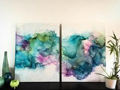 """Tell Me the Truth"" commissioned abstract diptych by abstract artist Amanda Moody. Alcohol ink, resin, mixed media on Claybord - Amanda Moody (@bombshelves) on Instagram: ""New commission ""Tell Me the Truth"" 30x40in(each) mixed media diptych on Claybord is on its way for…"""