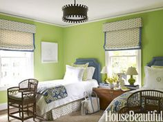 "Joyful Bedroom: This designer painted guest-room walls Benjamin Moore's Stem Green: ""It immediately made this simple little space so happy."""